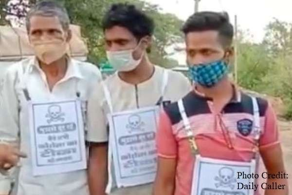 """In India, mandatory skull tags and warnings are being placed on those who are not vaccinated. The signs read """"stay away from me"""" and are in the form of pamphlets attached to their .."""